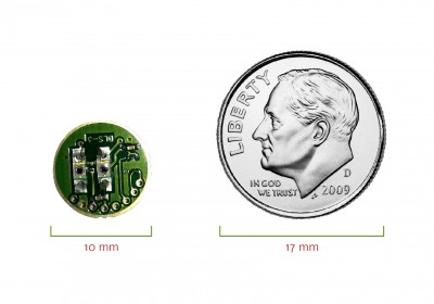 Elfi-Tech sensor next to a US dime, showing miniaturized size